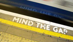platform at train station with mind the gap sign-SansDesk